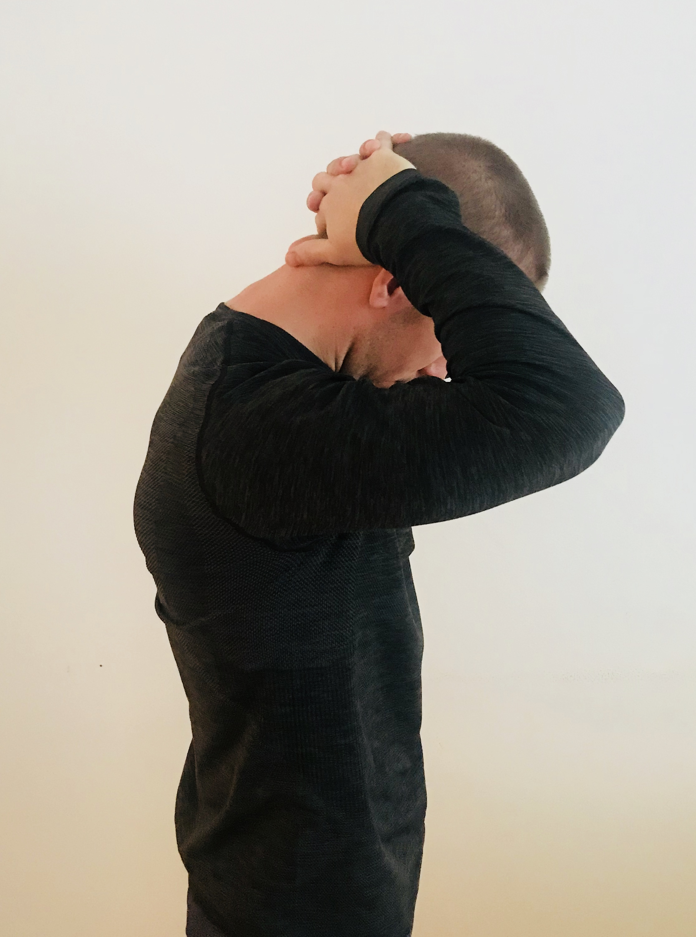 The chin to chest stretch is perfect for relieving the tension in your neck to help your headaches.
